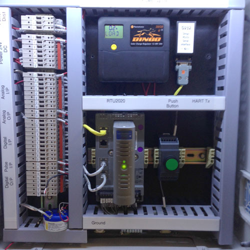 Honeywell RTU2020 Process Controller in a panel with solar panel power regulation